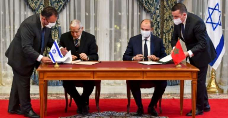 Representatives of Israel and Morocco sign landmark agreements at the Royal Palace in the Moroccan capital Rabat on December 22, 2020.  By FADEL SENNA (AFP)
