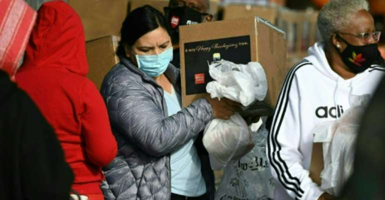 Residents hit financially by the pandemic receive Thanksgiving meal boxes at in Los Angeles, California, on November 20, 2020.  By Robyn Beck (AFP)