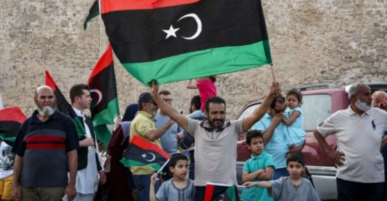Residents of Tripoli celebrate after Libya's UN-recognised unity government announces it is back in full control of the capital and its suburbs.  By Mahmud TURKIA (AFP)