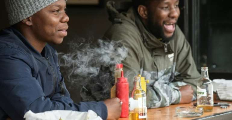 Restrictions have eased in South Africa allowing again for the sale of alcohol and cigarettes.  By RODGER BOSCH (AFP)