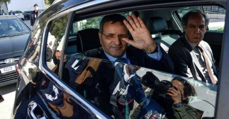 Retired Algerian army general Ali Ghediri waves as he arrives to submit his candidacy to the constitutional council for the March 2019 presidential election.  By RYAD KRAMDI (AFP/File)