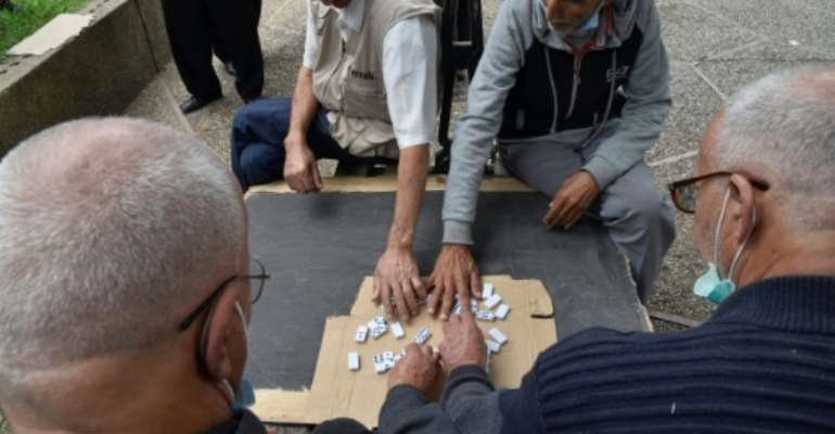 Retired Algerians play chess in a park in Bab El-Oued, a stronghold of the Hirak protest movement, as the country prepares to vote on constitutional changes.  By RYAD KRAMDI (AFP)