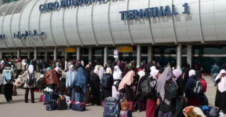 People crowd the entrance to Cairo's International Airport.  By Michel Moutot (AFP/File)