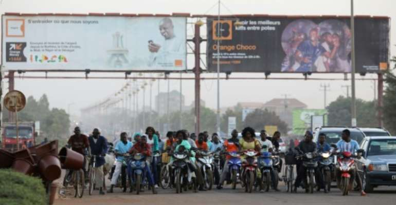 Riding motorbikes and bicycles is very popular in Burkina Faso.  By LUDOVIC MARIN (AFP/File)
