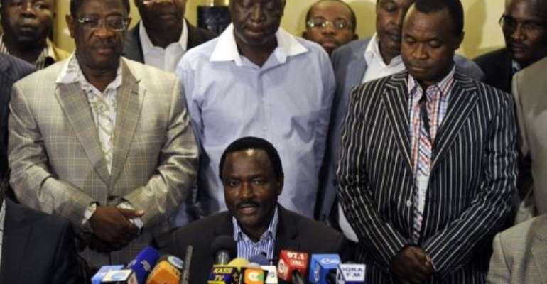 Kalonzo Musyoka (bottom), Prime Minister Raila Odinga's running mate, gives a press conference, March 7, 2013 in Nairobi.  By Tony Karumba (AFP)