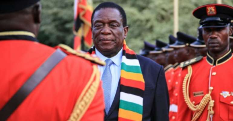 Rights groups claim the new Zimbabwe government, headed by President Emmerson Mnangagwa, has committed abuses.  By Tina SMOLE (AFP)