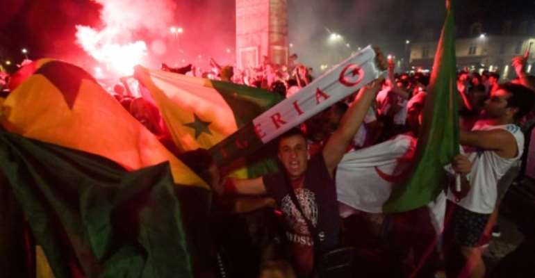 Riotous celebrations erupted around France after the Algerian football team qualified for the final of the Africa Cup of Nations.  By MEHDI FEDOUACH (AFP)