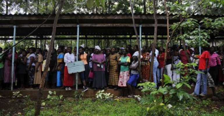 Kenyans queue up to vote in political party primary nominations on January 17, 2013, in Kisumu.  By Tony Karumba (AFP/File)
