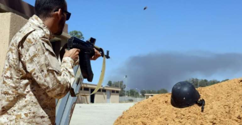 Rival Libyan forces have been battling for control of the capital Tripoli and analysts say they are creating a security vacuum allowing jihadists to re-emerge.  By Mahmud TURKIA (AFP/File)