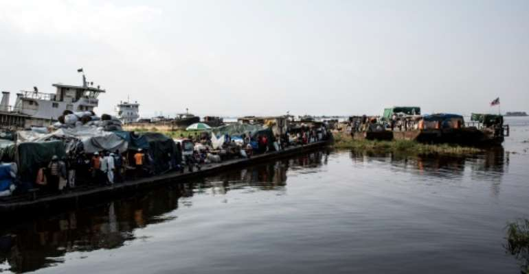 Rivers and waterways are widely used for travel in the Democratic Republic of Congo in the absence of paved roads and railways.  By JOHN WESSELS (AFP/File)