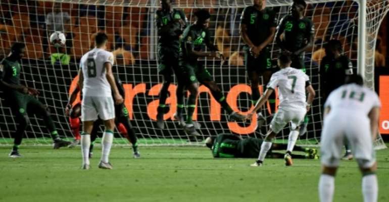 Riyad Mahrez's 95th-minute free-kick knocked Nigeria out in the Africa Cup of Nations semi-finals.  By JAVIER SORIANO (AFP)