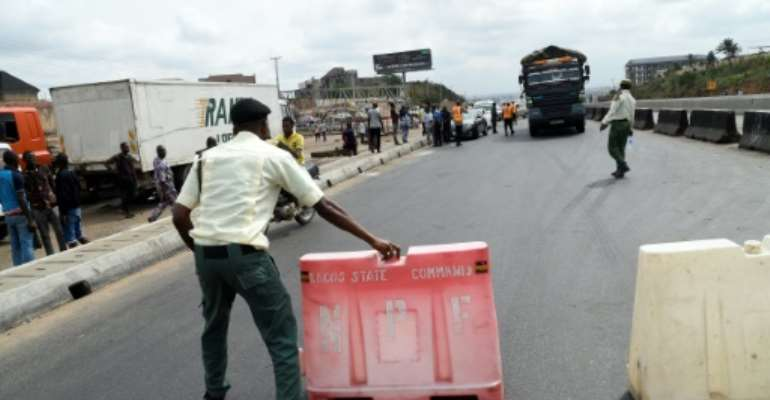 Road block: Lagos, Africa's biggest city, has been in lockdown since March 31.  By PIUS UTOMI EKPEI (AFP/File)