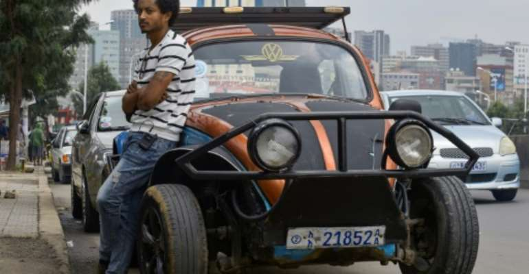 Robel Wolde extensively restored a beat-up 1967 Volkswagen Beetle that he bought from a friend for 50,000 Ethiopian birr (about 1,540 euros, $1,700).  By MICHAEL TEWELDE (AFP)