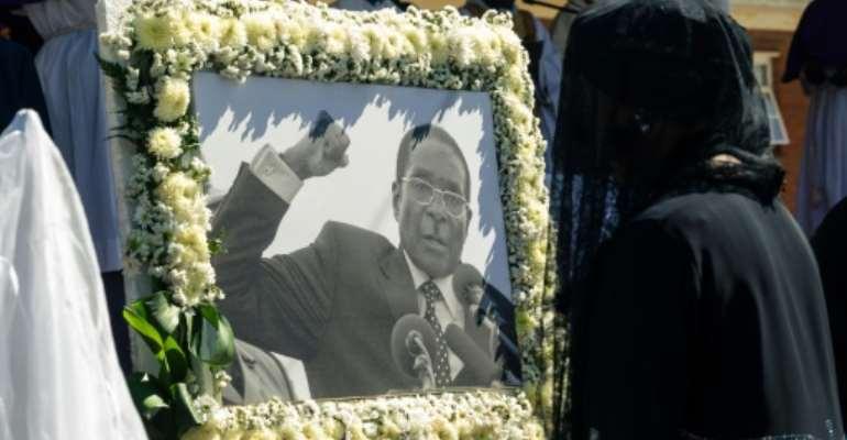 Robert Mugabe died aged 95 in a Singapore hospital.  By Jekesai NJIKIZANA (AFP/File)