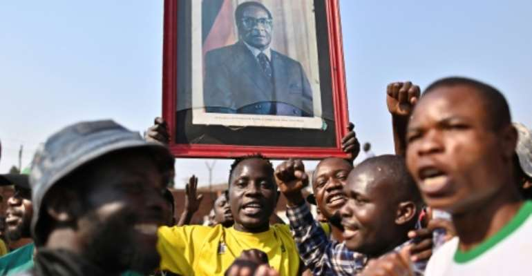 Robert Mugabe's death has left Zimbabweans torn over the legacy of the anti-colonial guerrilla hero whose iron-fisted rule ended in a coup in 2017.  By TONY KARUMBA (AFP)