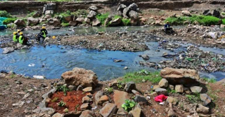 Rock arrangements mark the ground where authorities say bodies, mostly babies, were recovered from Nairobi's rivers.  By TONY KARUMBA (AFP)