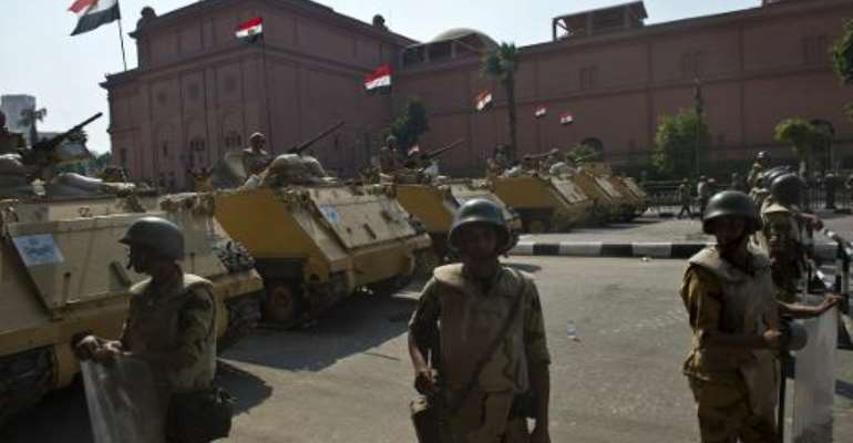 Egyptian soldiers stand guard outside Tahrir Square in Cairo, on October 6, 2013.  By Khaled Desouki (AFP/File)