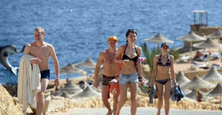 Tourists pictured returning from the beach in the Egyptian resort of Sharm el-Sheikh on November 7, 2015.  By Mohamed El-Shahed (AFP)