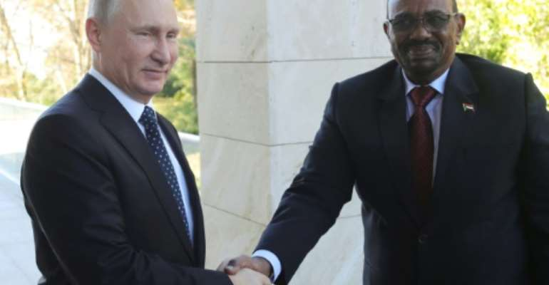 Russian President Vladimir Putin met his Sudanese counterpart Omar al-Bashir during a meeting in Sochi on November 23.  By Mikhail KLIMENTYEV (SPUTNIK/AFP/File)