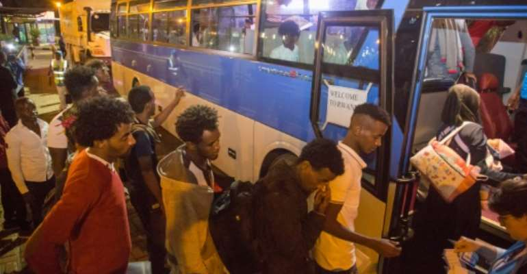 Rwanda first offered to take in Africans stuck in Libya back in November 2017, the same month a CNN report showed what appeared to be a slave market there.  By Cyril NDEGEYA (Rwanda's Ministry of Emergency Management (MINEMA)/AFP)