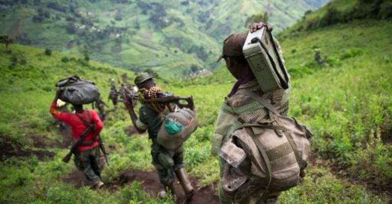 This picture taken on November 30, 2012 shows M23 rebels withdrawing through the hills having left their position in the village of Karuba.  By Phil Moore (AFP/File)