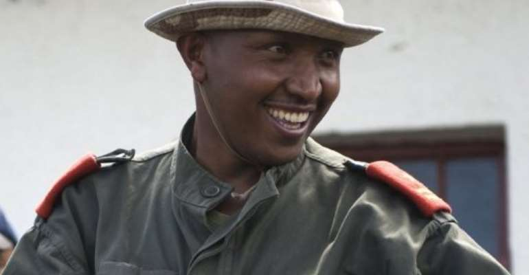 Bosco Ntaganda receives a Congolese army uniform during an integration ceremony in eastern DR Congo on January 29, 2009.  By Walter Astrada (AFP/File)