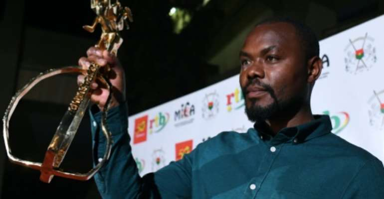 Rwandan director Joel Karekezi, winner of the Golden Stallion of Yennenga in 2019 for 'The Mercy of the Jungle.' The trophy is named after a beast in Burkinabe mythology.  By ISSOUF SANOGO (AFP)