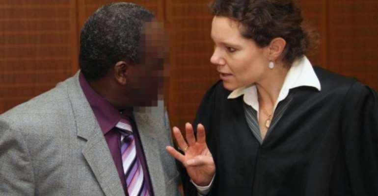 Former Rwandan mayor Onesphore Rwabukombe (L) talks with his lawyer, Natalie von Wistinghausen, as he arrives at court in Frankfurt, Germany, on January 18, 2011.  By Daniel Roland (AFP/File)