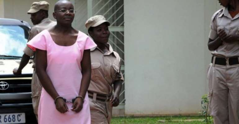 Victoire Ingabire is led to the Rwandan High Court in 2011.  By Steve Terrill (AFP/File)