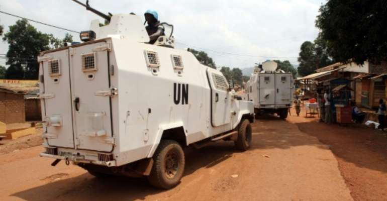 Rwandan police officers from the United Nations Multidimensional Integrated Stabilisation Mission in the Central African Republic (MINUSCA) in armoured vehicles patrol the market in Bangui September 14, 2015; Only small contingents of MINUSCA remain.  By EDOUARD DROPSY (AFP/File)