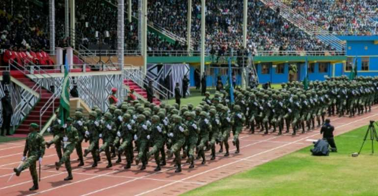 Rwandan soldiers march during the swearing-in ceremony for President Paul Kagame's third term in August.  By CYRIL NDEGEYA (AFP/File)