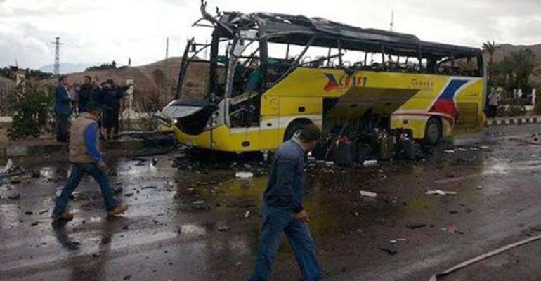 Police look at the wreckage of a tourist bus at the site of a bomb explosion in Egypt on February 16, 2014.  By  (AFP)