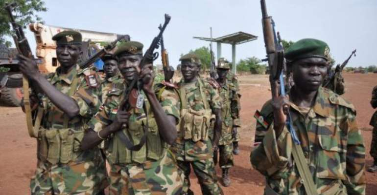 South Sudanese soldiers pose on April 23, 2012 at a base near Bentiu.  By Hannah Mcneish (AFP/File)
