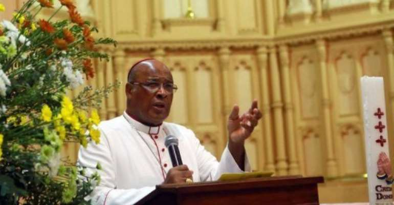 Cardinal Wilfrid Fox Napier, the Archbishop of Durban, addresses worshippers in Durban, on February 10, 2013.  By Rajesh Jantilal (AFP/File)