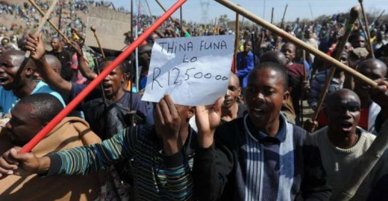 Miners demonstrate near Rustenberg on August 16.  By - (AFP)