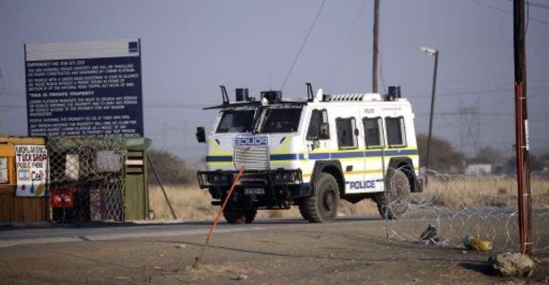 A police vehicle parked outside the Marikana platinum mine on August 21, 2012.  By Stephane de Sakutin (AFP/File)