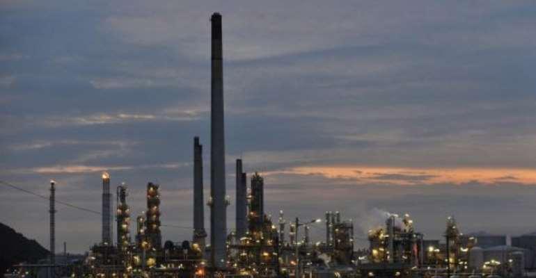 Smoke billows from Sapref South African Petroleum Refinery just outside Durban City.  By Alexander Joe (AFP/File)