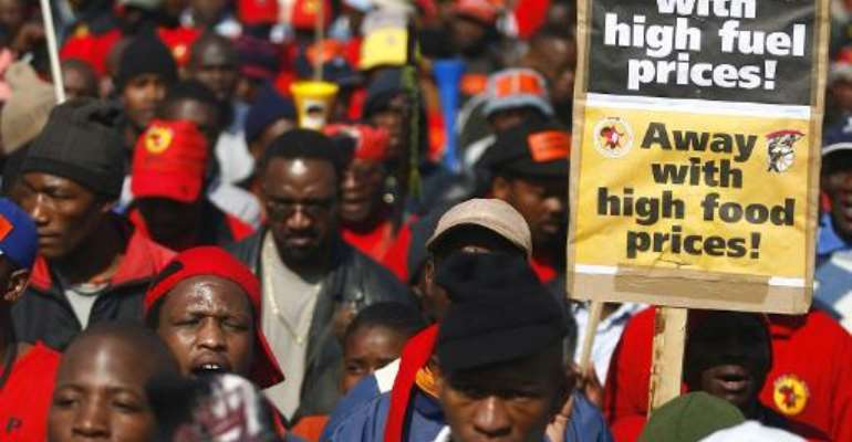 South African protestors march to the Eskom offices in Johannesburg on July 23, 2008.  By Paballo Thekiso (AFP/File)