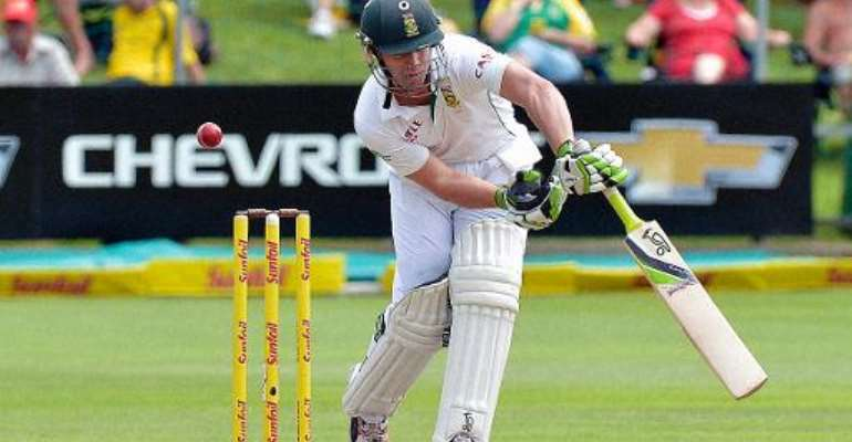 AB de Villiers plays a shot on his way to a century for South Africa against Australia at St George's Park in Port Elizabeth on February 21, 2014.  By Alexander Joe (AFP)