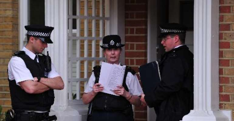Police officers stand outside a house in New Malden, south London, on April 23, 2014 after three children were found dead at the house on the previous day.  By Carl Court (AFP)