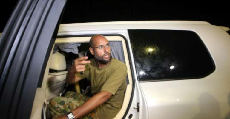 Saif al-Islam Kadhafi, shown in this file photo taken on August 23, 2011 in the Libyan capital Tripoli, is said to have been freed after more than five years in captivity.  By IMED LAMLOUM (AFP/File)