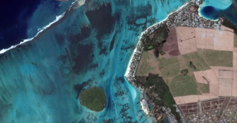 Salvage crews are racing round the clock to clean sludge.  By Handout (Satellite image ©2020 Maxar Technologies/AFP/File)