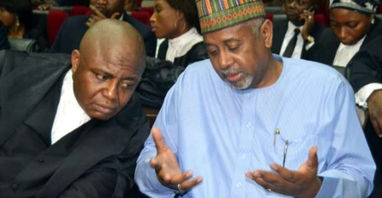 Sambo Dasuki (R) is accused of siphoning money earmarked for the fight against Islamic militant group Boko Haram and allegedly using it to help bankroll former president Goodluck Jonathan's failed re-election campaign in 2015.  By STRINGER (AFP/File)