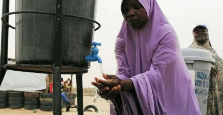 Sanitation at the Bakassi camp for displaced people is basic - experts fear a catastrophe if the coronavirus takes root.  By Audu Marte (AFP)