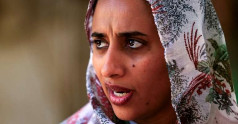 Sarah al-Fateh, general manager at Teital Oil Mills in Sudan's capital, says she is unable to import replacement parts due to sanctions.  By Ashraf SHAZLY (AFP)