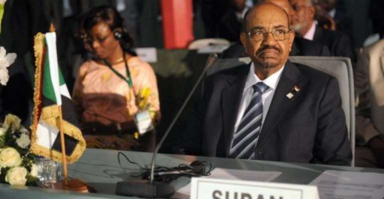 Omar al-Bashir at the African Union Summit on health in Abuja on July 15, 2013.  By Pius Utomi Ekpei (AFP)