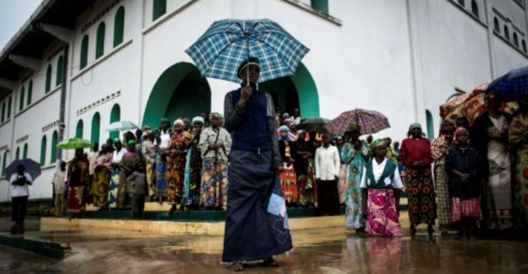 Scene from Kimbanguist devotees' daily morning prayer in Nkamba in 2017.  By JOHN WESSELS (AFP/File)