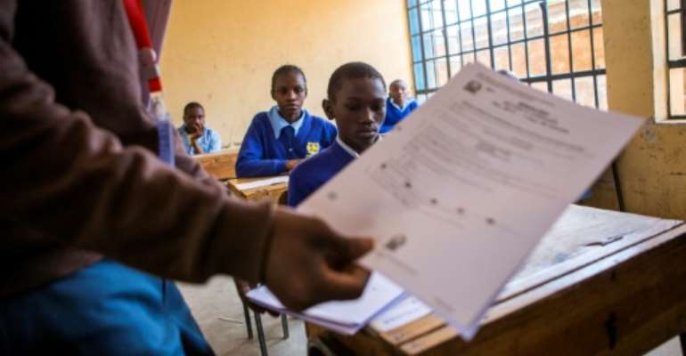 School's out: Primary and secondary pupils in Kenya have been told to return to class in January because of coronavirus.  By PATRICK MEINHARDT (AFP)