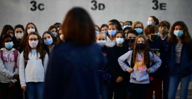 Schools reopened in Russia, Ukraine, Belgium and France, where teachers and their pupils aged 11 and older were obliged to wear face coverings.  By Martin BUREAU (AFP)