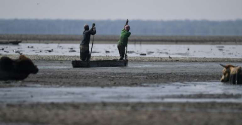 Scientists believe early humans lived in the wetlands south of the Zambezi river for 70,000 years before climate change allowed them to expand.  By MONIRUL BHUIYAN (AFP/File)